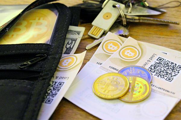 Ce qui est un portefeuille de Bitcoins et sont de types?